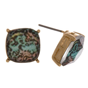 Stud earrings featuring a iridescent stone with leopard print details. Approximately 1cm in diameter.