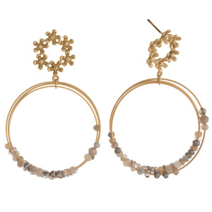 """Circular metal drop earrings featuring iridescent bead accents with a flower stud detail. Approximately 2"""" in length."""