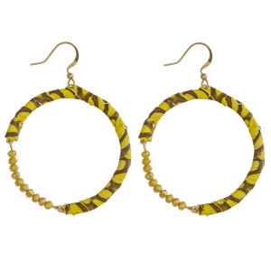 """Genuine leather snakeskin wrapped round earrings featuring faceted beaded details. Approximately 2.5"""" in length."""