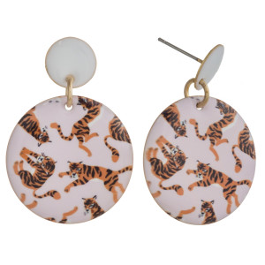 """Metal disc earrings featuring tiger print enamel details. Approximately 1"""" in length."""
