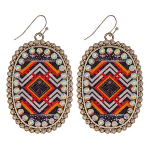 """Metal drop earrings featuring a faux leather western center detail with rhinestone accents. Approximately 2.5"""" in length."""