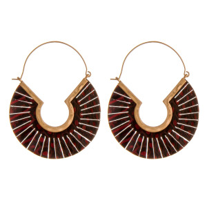 """Genuine leather snakeskin feather wire hoop earrings. Approximately 2"""" in length."""
