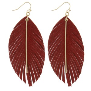 """Cowhide feather earrings featuring a gold bar accent.  - Approximately 3.5"""" in length"""
