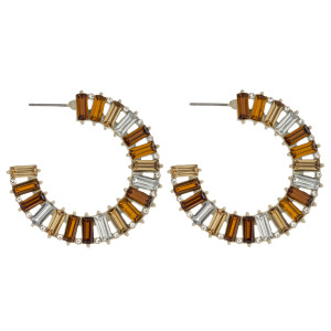 """Rhinestone accented open hoop starburst earrings with cubic zirconia details. Approximately 2"""" in diameter."""