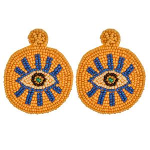"""Oversized seed beaded felt disc evil eye earrings. Approximately 3"""" in length."""