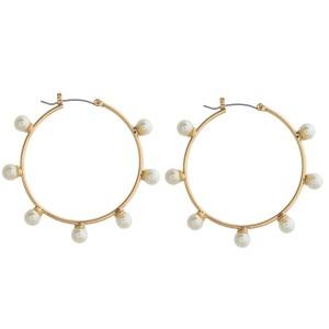 "Pearl beaded pin catch hoop earrings. Approximately 2"" in diameter."