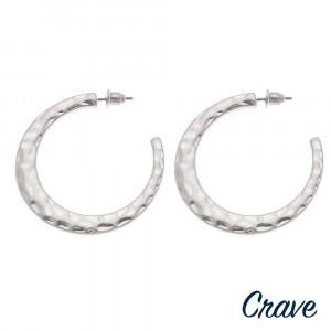 """Hammered metal open hoop earrings. Approximately 1.5"""" in diameter."""