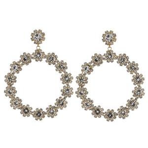 "Rhinestone flower open circle dangle earrings. Approximately 3"" in length."