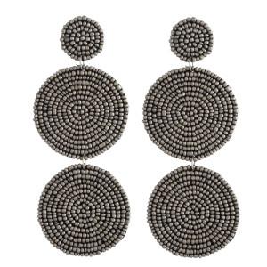 "Oversized seed beaded felt double disc dangle earrings. Approximately 4.5"" in length."
