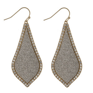 "Rhinestone glitter encased arabesque drop earrings. Approximately 2.5"" in length."
