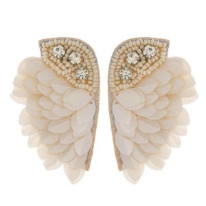 """Oversized felt wing earrings featuring rhinestone accents. Approximately 3"""" in length."""