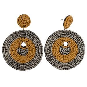 "Seed beaded felt disc boho drop earrings. Approximately 3"" in length and 2"" in diameter."