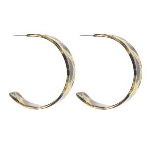 "Leopard print resin open hoop earrings.  - Approximately 2"" in diameter"