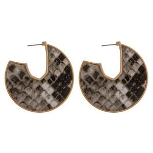 """Faux leather snakeskin encased open hoop disc earrings.  - Approximately 2"""" in diameter"""