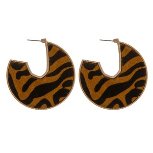 """Cowhide animal print encased open hoop disc earrings.  - Approximately 2"""" in diameter"""