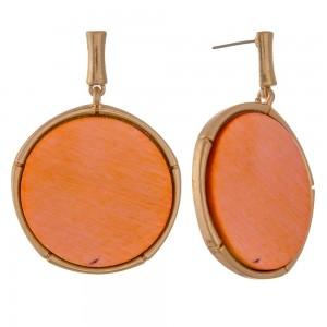 "Modern wood encased drop disc earrings.  - Approximately 2"" in length and 1.5"" in diameter"