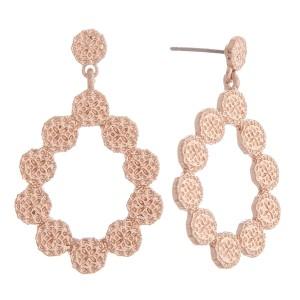 """Matte metal flower textured teardrop earrings.  - Approximately 1.5"""" in length"""