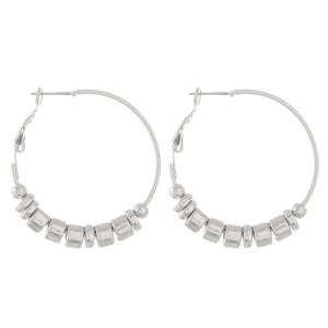 """Metal tone beaded hoop earrings.  - Approximately 1.5"""" in diameter"""
