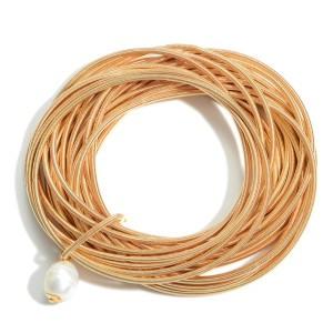 """Set of Twenty-Five Spring Wire Elastic Bracelets Featuring Faux Pearl Accent.   - Approximately 3"""" in Diameter"""