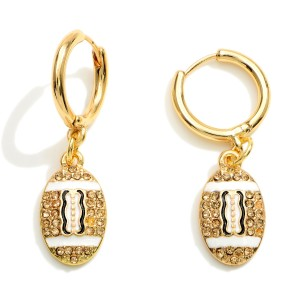 """Gold Huggie Hoop Earrings Featuring a CZ Football Charm.  - Approximately 1.25"""" in Length"""