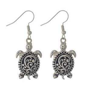 """Silver sea turtle earrings featuring a filigree design. Approximately 1 1/4"""" in length."""