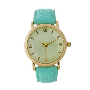 Mint green genuine leather watch featuring a mint green face and Roman numeral numbers.