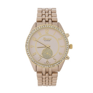 Matte gold tone metal watch with a monochromatic face and clear rhinestone accents.