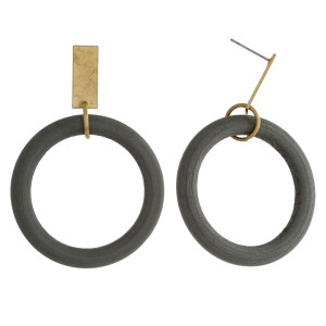 """Circular wood earrings featuring a gold metal stud accent. Approximately 2"""" in length."""
