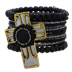 Cuff bracelet featuring black, grey, and blue bead decor with a large mixed metal cross focal.