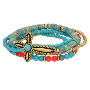 Multiple strand stretch bracelet featuring turquoise and coral beads with a gold tone cross focal.
