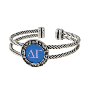 Burnished silver tone officially licensed Delta Gamma cuff bracelet with rhinestone accents.