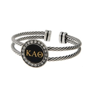 Burnished silver tone officially licensed Kappa Alpha Theta cuff bracelet with rhinestone accents.