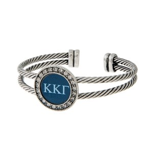Burnished silver tone officially licensed Kappa Kappa Gamma cuff bracelet with rhinestone accents.