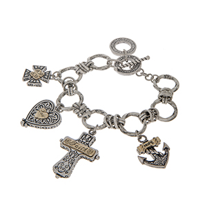 "Two tone toggle bracelet with cross, heart, and anchor charms. Approximately 7 1/2"" in length."