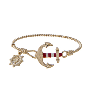 Gold tone latch bangle bracelet with a red and white thread wrapped anchor and a ships wheel charm.