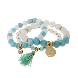 "Three row stretch bracelet displaying blue and white stone beads with a 1 1/4"" mint fabric tassel."