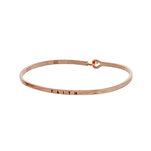 "Rose gold tone latch bangle bracelet stamped ""FAITH""."
