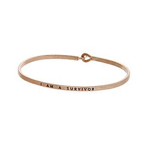 """Rose gold tone latch bangle bracelet stamped """"I AM A SURVIVOR""""."""