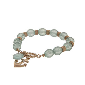 Mint glass beaded stretch bracelet with a gold tone anchor charm.