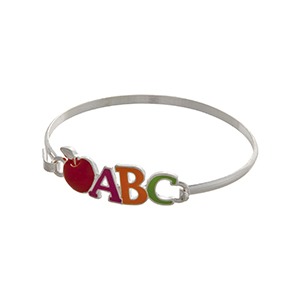 "Silver tone latch bangle bracelet displaying a multicolored ""ABC"" and a red apple. Great teacher appreciation gift!"