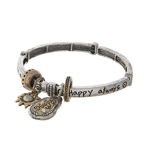"Burnished silver tone stretch bangle bracelet displaying a two tone flower charm and a plate stamped ""Happy always""."
