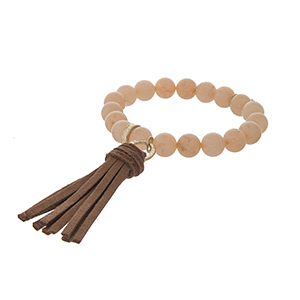 Peach stone brown tassel stretch bracelet.