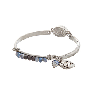"Silver tone magnetic clasp bangle bracelet displaying gray beads and a plate stamped ""free spirit""."