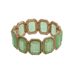 Gold tone rectangular stretch bracelet with mint green iridescent cabochons.