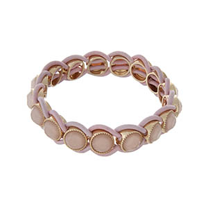 Stretch bracelet with pale pink stones and gold tone hardware.