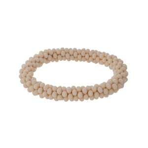 Ivory beaded stretch bracelet.