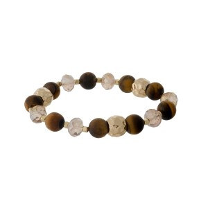 Beaded stretch bracelet with gray faceted beads, hammered gold tone beads, and tiger's eye natural stone beads. Handmade in the USA.