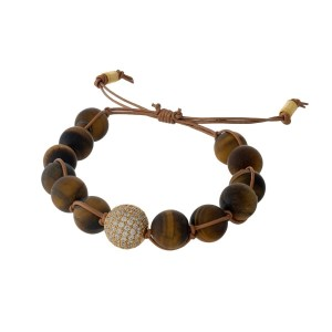 Adjustable cord bracelet with matte tiger's eye beads and a clear rhinestone pave bead. Handmade in the USA.