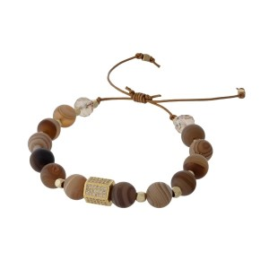 Adjustable cord bracelet with brown agate natural stone beads, gold tone square beads, and clear rhinestones. Handmade in the USA.