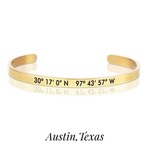 Gold tone cuff bracelet stamped with the coordinates of Austin, Texas. Home of the University of Texas.